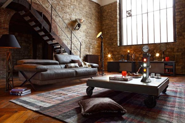 High-Ceiling-Model-and-Industrial-Design-Living-Room-with-Cool-Floor-Lamps-and-Wooden-Floor-909x576