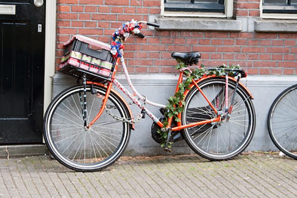 Painted bicycle, decorated with artificial flowers